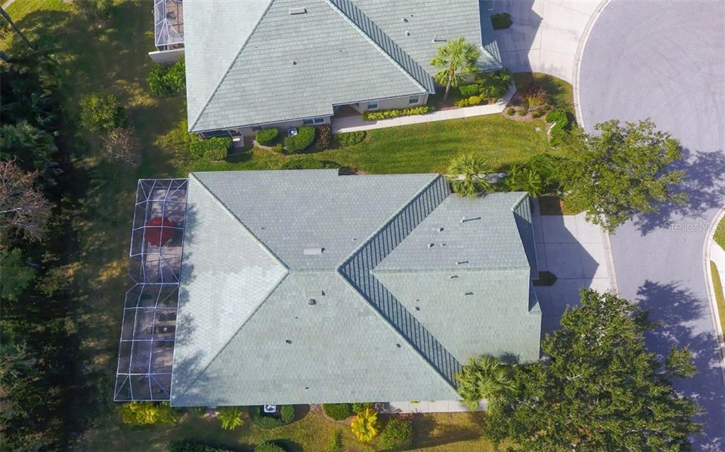 Aerial view, new roof in 2020. - Villa for sale at 4812 Lakescene Pl, Sarasota, FL 34243 - MLS Number is A4486070