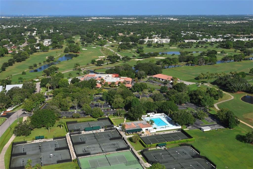 Aerial view of Palm Aire Country Club - Villa for sale at 4812 Lakescene Pl, Sarasota, FL 34243 - MLS Number is A4486070