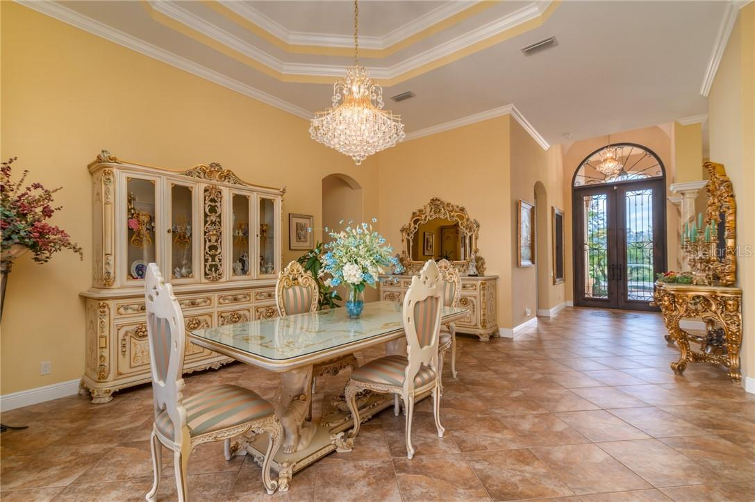 The current owners swapped the Formal Living Room, seen in this photo, with the Dining Room to accommodate large family gatherings around the Dining Room Table. - Single Family Home for sale at 11720 Rive Isle Run, Parrish, FL 34219 - MLS Number is A4486302