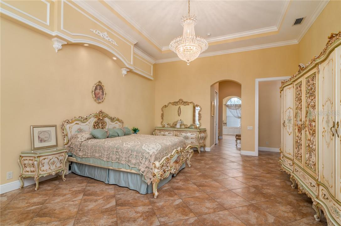The Owner's Suite was enlarged during the design and construction to give the owners a real retreat at the end of the day.  It features two large walk-in closets with a large dressing area between them leading into the Owners' Bathroom. - Single Family Home for sale at 11720 Rive Isle Run, Parrish, FL 34219 - MLS Number is A4486302
