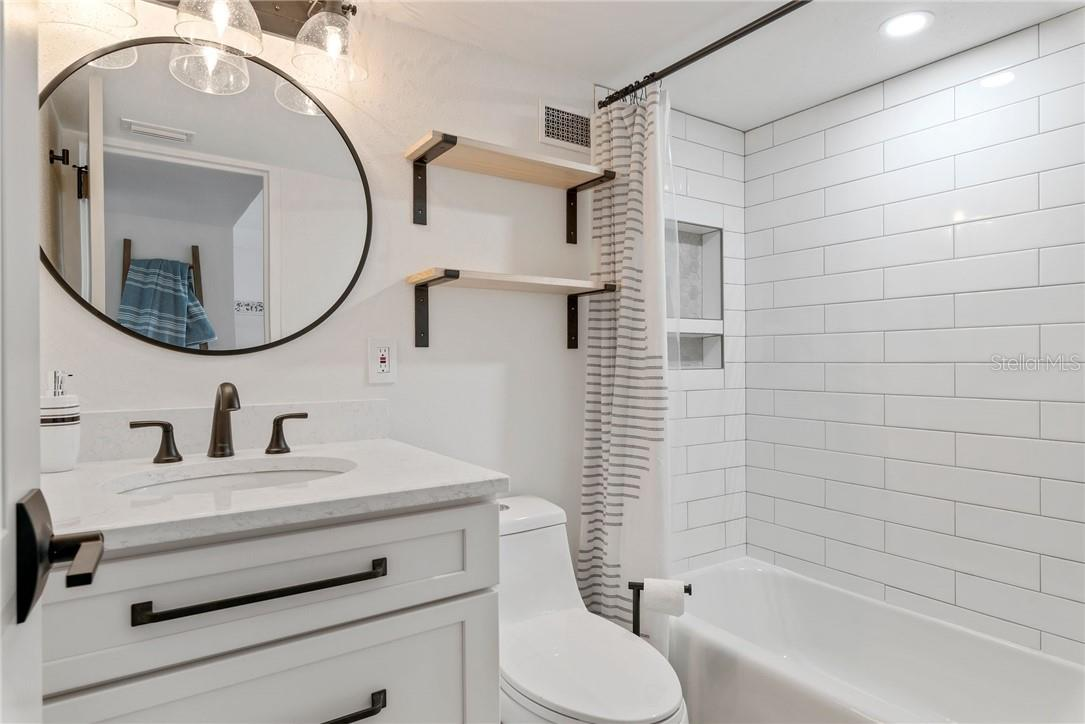 Fully Renovated Bathroom with custom vanity - Condo for sale at 33 S Gulfstream Ave #405, Sarasota, FL 34236 - MLS Number is A4489097