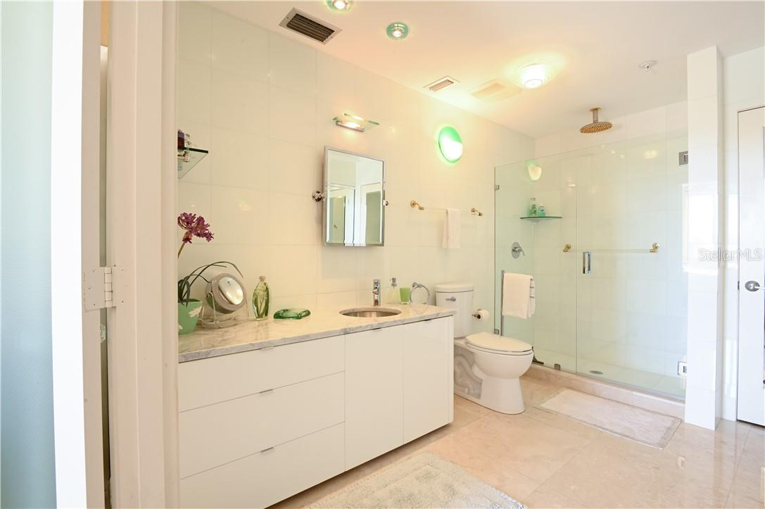 Master Bath-Room with Marble Counter-Top and Tiled Walls - Condo for sale at 1945 Gulf Of Mexico Dr #M2-505, Longboat Key, FL 34228 - MLS Number is A4489188