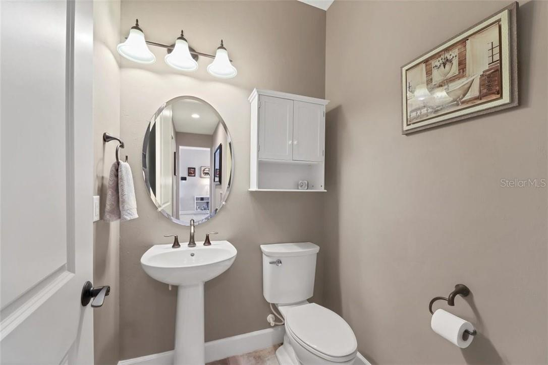 Powder room on first floor - everyone wants the privacy of a powder room for their guests. - Single Family Home for sale at 11713 Blue Hill Trl, Bradenton, FL 34211 - MLS Number is A4490622