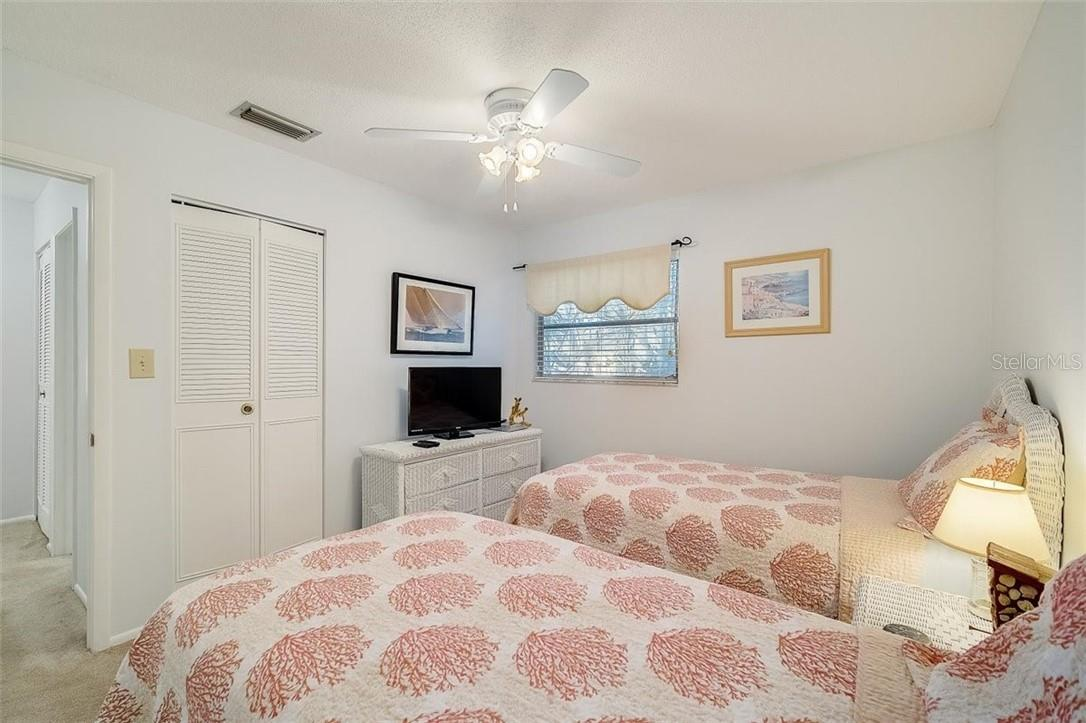 577 Sutton Place Longboat Key Florida 34228 | 2nd Bedroom with 2 Closets - Condo for sale at 577 Sutton Pl #T-25, Longboat Key, FL 34228 - MLS Number is A4492432