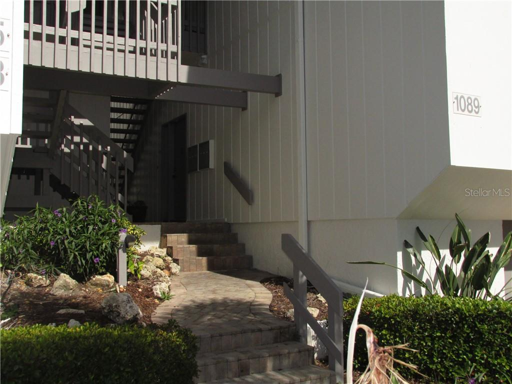 ENTRANCE TO UNIT 1087 - Condo for sale at 1087 W Peppertree Dr #221d, Sarasota, FL 34242 - MLS Number is A4493593