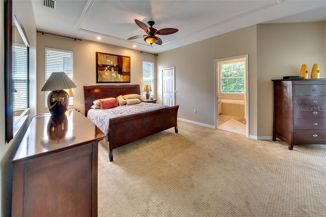 Romantic Owner's Suite with Sliders to the Pool - Single Family Home for sale at 7739 Us Open Loop, Lakewood Ranch, FL 34202 - MLS Number is A4494156