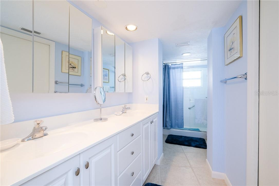 Master Bathroom with Double Vanity and Walk-In Closet - Condo for sale at 6300 Midnight Pass Rd #701, Sarasota, FL 34242 - MLS Number is A4496847
