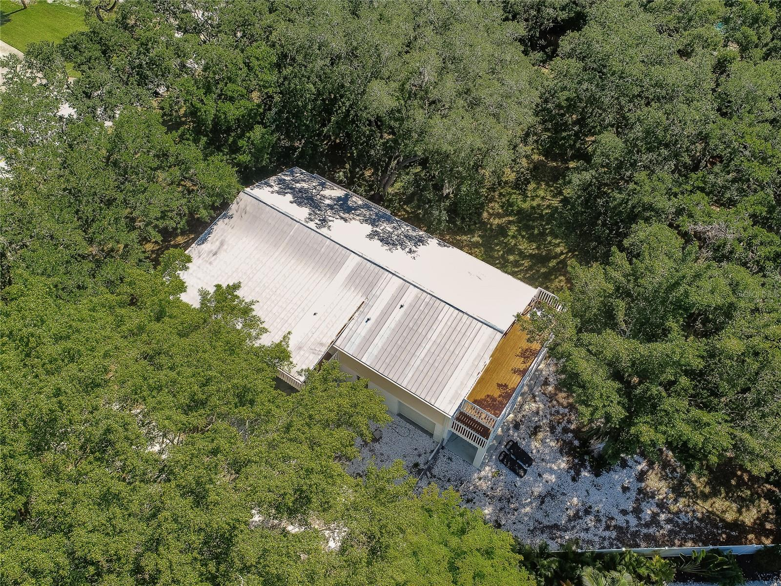 Metal roof and top deck. - Single Family Home for sale at 7811 27th Ave W, Bradenton, FL 34209 - MLS Number is A4499385