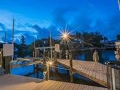 Dock at dusk - Single Family Home for sale at 5555 Cape Leyte Dr, Sarasota, FL 34242 - MLS Number is A4157475