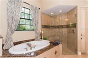 Master Shower & Bath - Single Family Home for sale at 1620 Assisi Dr #19, Sarasota, FL 34231 - MLS Number is A4163976