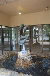 the Dolphin Fountain at the building entry - Condo for sale at 101 S Gulfstream Ave #11a, Sarasota, FL 34236 - MLS Number is A4168207