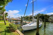 Beautiful Dock with 10,000lb boat lift & Room for a Sail Boat too!  No Stress with No Bridges to the Gulf! Dock includes Water & Electric. - Single Family Home for sale at 722 Siesta Dr, Sarasota, FL 34242 - MLS Number is A4169257