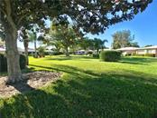 Common area behind villas - Villa for sale at 3230 Brunswick Ln #709, Sarasota, FL 34239 - MLS Number is A4175978