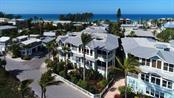 Gracious Key West style architecture sets the tone for Florida living! - Condo for sale at 318 Bay Dr S #7, Bradenton Beach, FL 34217 - MLS Number is A4178742