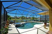 Pool and Spa overlooking lake - Single Family Home for sale at 9006 Heritage Sound Dr, Bradenton, FL 34212 - MLS Number is A4183771