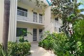 Entry - unit is second door from the left upstairs - Condo for sale at 100 73rd St #202a, Holmes Beach, FL 34217 - MLS Number is A4184505