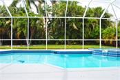 Newly resurfaced pool and pool cage. - Single Family Home for sale at 9113 17th Dr Nw, Bradenton, FL 34209 - MLS Number is A4186407