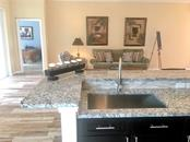 kitchen breakfast bar open to great room - Single Family Home for sale at 831 Placid Lake Dr, Osprey, FL 34229 - MLS Number is A4187075