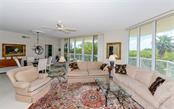 Sliders throughout living room and dining room - Condo for sale at 1800 Benjamin Franklin Dr #a202, Sarasota, FL 34236 - MLS Number is A4187131