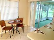 eat-in area leading to back patio - Villa for sale at 510 Villa Park Dr #510, Nokomis, FL 34275 - MLS Number is A4188232