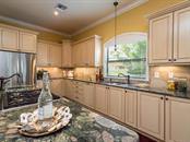 Easy to cook great meals in the Chef's kitchen complete with the gas appliances including a Wolf cook top. - Single Family Home for sale at 1884 Grove St, Sarasota, FL 34239 - MLS Number is A4189365