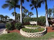 Community entrance - Condo for sale at 19 Whispering Sands Dr #205, Sarasota, FL 34242 - MLS Number is A4189914