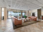 Building lobby area overlooking pool & Gulf - Condo for sale at 1750 Benjamin Franklin Dr #5g, Sarasota, FL 34236 - MLS Number is A4192160