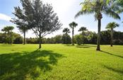 Serene view of the preserve from your Lanai - Villa for sale at 2127 Burgos Dr, Sarasota, FL 34238 - MLS Number is A4195921