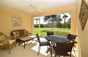 Screened outdoor living space is very private. - Villa for sale at 2127 Burgos Dr, Sarasota, FL 34238 - MLS Number is A4195921