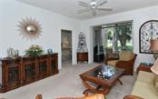 Spacious living room with sliders to glass enclosed lanai. - Condo for sale at 9570 High Gate Dr #1712, Sarasota, FL 34238 - MLS Number is A4196327