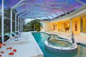 An evening, poolside. - Single Family Home for sale at 7332 Chelsea Ct, University Park, FL 34201 - MLS Number is A4196805