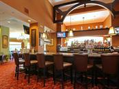 Dining/Bar area of the clubhouse. - Villa for sale at 8773 Pebble Creek Ln, Sarasota, FL 34238 - MLS Number is A4197786