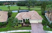 Aerial Front Exterior - Single Family Home for sale at 9919 Portside Ter, Bradenton, FL 34212 - MLS Number is A4197815