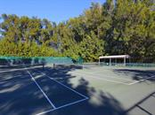 Two of three tennis courts for Sanderling Club - Single Family Home for sale at 7340 Pine Needle Rd, Sarasota, FL 34242 - MLS Number is A4200855
