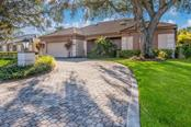 Pavered Circular Driveway and Two Car Garage - Single Family Home for sale at 5026 Kestral Park Way S, Sarasota, FL 34231 - MLS Number is A4203689