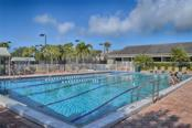 Swim laps in The Landings Pool. - Condo for sale at 1618 Starling Dr #105, Sarasota, FL 34231 - MLS Number is A4204864