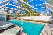 Screen enclosed pool area allows you to open sliders to the outside and enjoy beautiful weather. Private, fenced backyard. - Single Family Home for sale at 3508 Avenida Madera, Bradenton, FL 34210 - MLS Number is A4205393