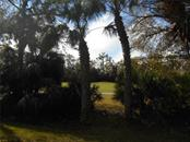This is the view from the dining area, great room and kitchen!  The 14th fairway and gorgeous mature landscaping!  So peaceful! - Condo for sale at 815 Montrose Dr #202, Venice, FL 34293 - MLS Number is A4206556