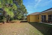 Exterior back - Single Family Home for sale at 1876 Bushnell Ave, North Port, FL 34286 - MLS Number is A4207073