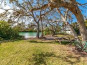 Community waterfront area a short stroll from your front door! - Single Family Home for sale at 411 Lyons Bay Rd, Nokomis, FL 34275 - MLS Number is A4209146