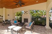 Outdoor covered gas fireplace for romantic winter evenings - Single Family Home for sale at 1179 Morningside Pl, Sarasota, FL 34236 - MLS Number is A4209174
