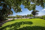 Bayside seating to watch the dolphins and manatees - Condo for sale at 6140 Midnight Pass Rd #608, Sarasota, FL 34242 - MLS Number is A4209897