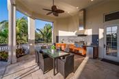 Outdoor kitchen and dining - Single Family Home for sale at 1503 Blue Heron Dr, Sarasota, FL 34239 - MLS Number is A4212851