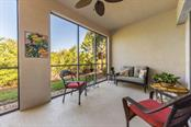10' X 24' Lanai overlooking the nature preserve - Condo for sale at 7504 Botanica Pkwy #101, Sarasota, FL 34238 - MLS Number is A4213208