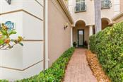 Front Door Entry - Condo for sale at 7504 Botanica Pkwy #101, Sarasota, FL 34238 - MLS Number is A4213208