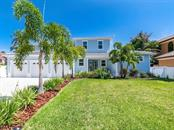 Casa Azul.  Coastal living at its finest.  3 car garage and plenty of parking for guest - Single Family Home for sale at 7643 Cove Ter, Sarasota, FL 34231 - MLS Number is A4403215