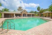 Community pool and clubhouse.  Great screened porch and Tiki bar shown to the right. - Condo for sale at 6540 Moorings Point Cir #202, Lakewood Ranch, FL 34202 - MLS Number is A4403403
