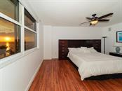 Master Bedroom - Glowing Sunsets Year Round - Condo for sale at 1800 Benjamin Franklin Dr #b409, Sarasota, FL 34236 - MLS Number is A4408201