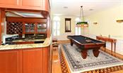 Wet bar next to game room - Single Family Home for sale at 1427 Cedar Bay Ln, Sarasota, FL 34231 - MLS Number is A4408881