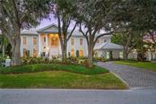 An impressive front exterior with two-story columns, double arched front doorway and circular drive for guests is just the beginning of this extraordinary home. - Single Family Home for sale at 1654 Landings Blvd, Sarasota, FL 34231 - MLS Number is A4417765